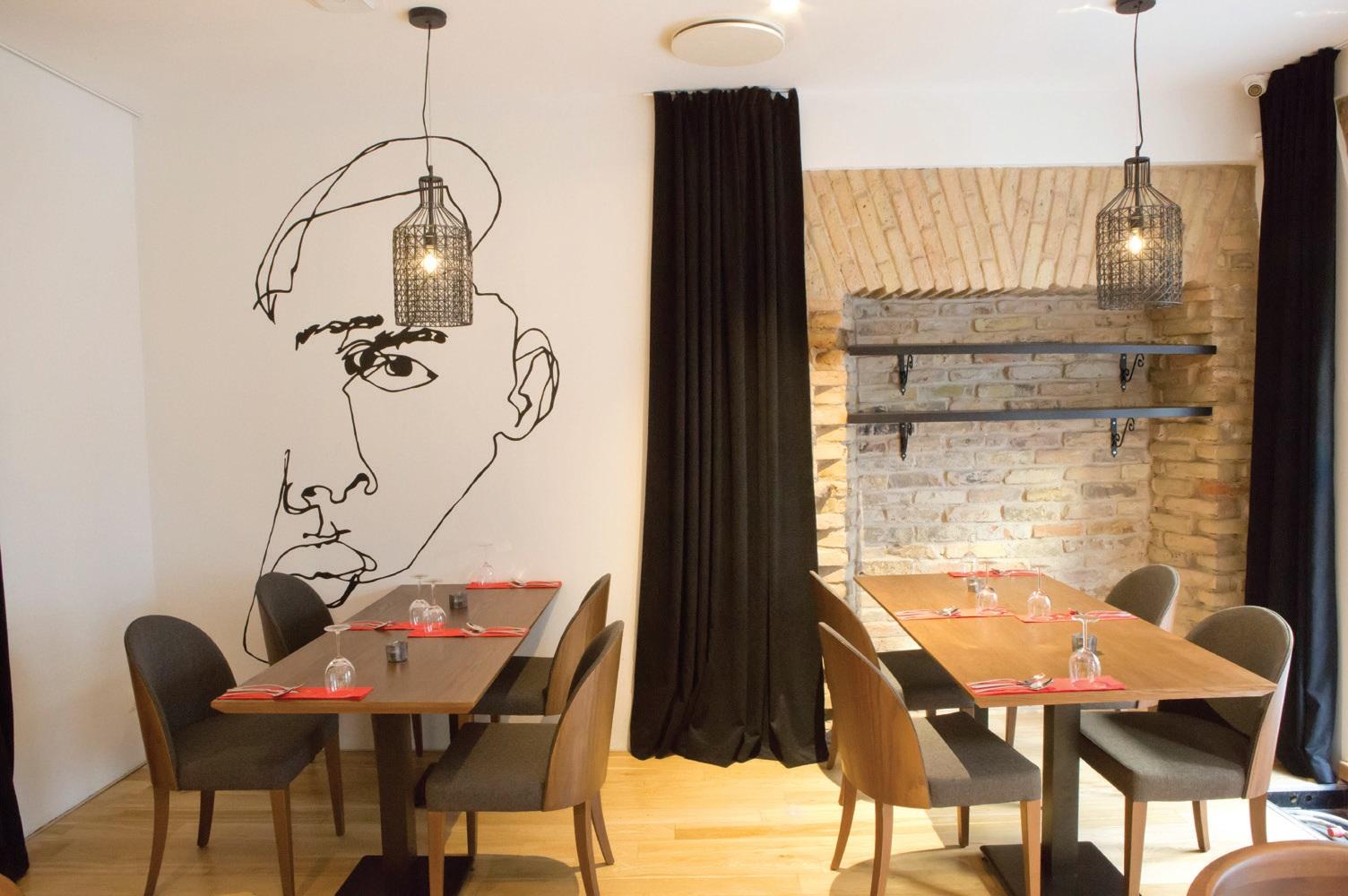 Nuosaikų restorano interjerą pagyvina išskirtinės detalės – kaip ir šis piešinys ant sienos